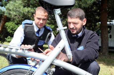 Cycle security marking. Police officers marking bike
