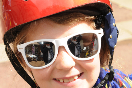 Girl with bike helmet and sunglasses