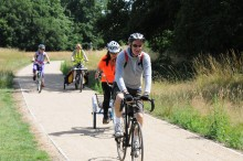 Transport Improvement Schemes. Group of cyclists in the park
