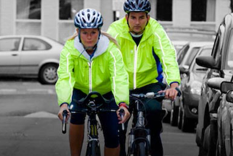 On-road-training. Two cyclists in high-vis clothing on the road